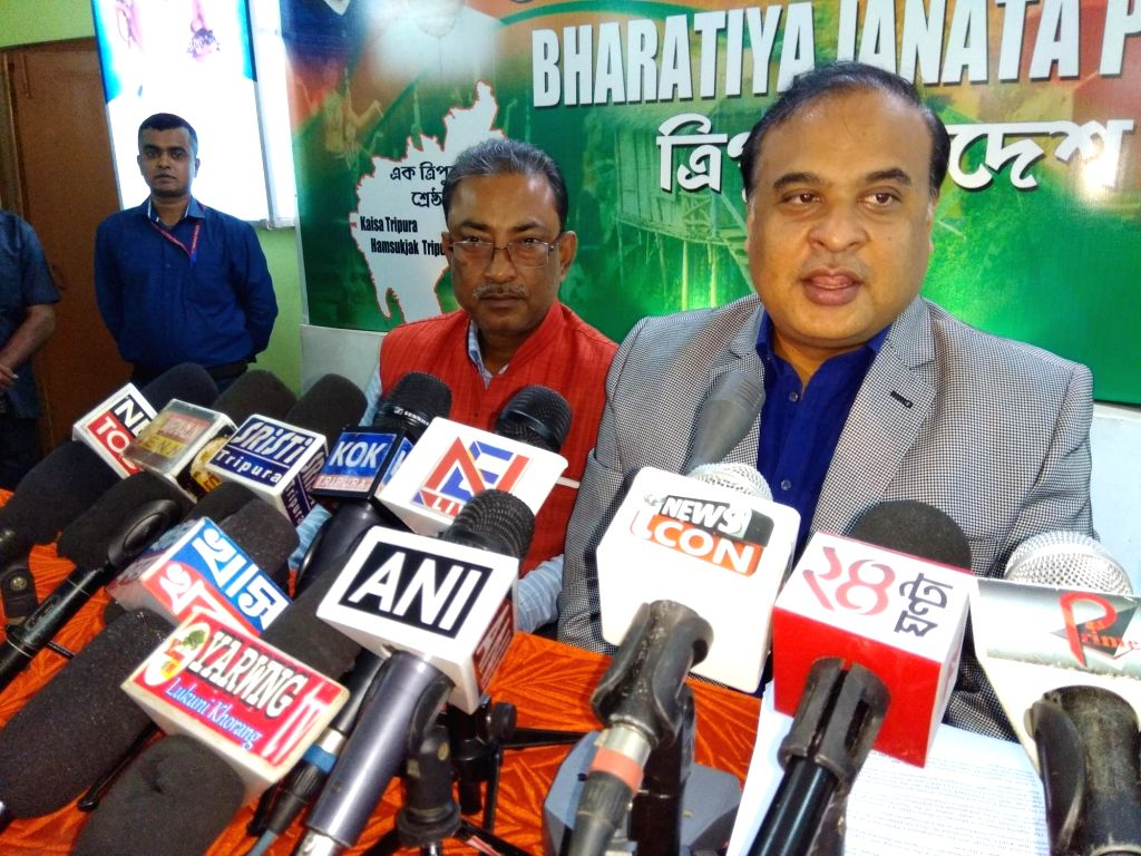 Assam Finance Minister and BJP's election in-charge for Tripura Himanta Biswa Sarma releases the joint statement of BJP and IPFT alliance during a press conference in Agartala on Feb 7, ...