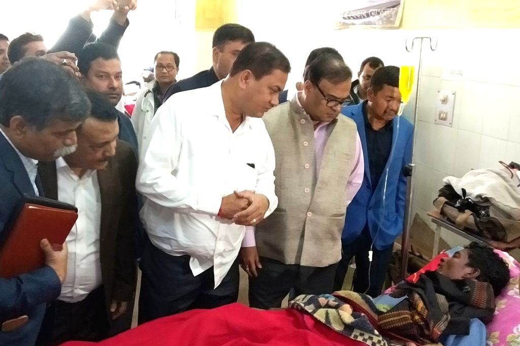 Assam Health Minister Himanta Biswa Sarma visits a victim, who was admitted after consuming spurious liquor in Assam's Jorhat, on Feb 24, 2019. - Himanta Biswa Sarma