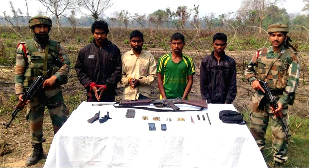 NSLA militants, who were apprehended in a joint operation of the Army and Assam Police being presented before press in Kashiabari village of Assam on March 13, 2015.
