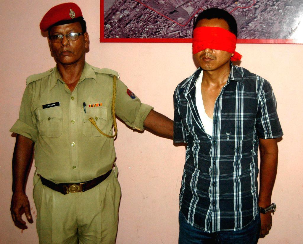 Assam Police arrest S. Tisso @Joy Tisso, Finance Secy of UPLA caught at Guwahati Railway Station, seen at Panbazar Police Station in Guwahati on June 17, 2014.