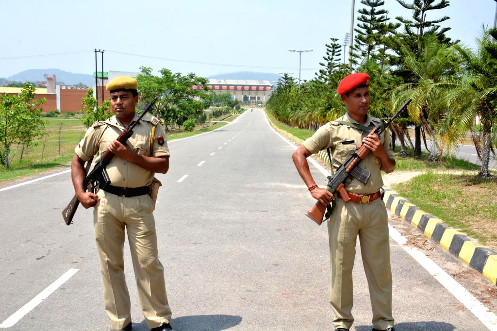 Assam police personnel deployed at Soru Sojai stadium complex where counting centre for 2014 Lok Sabha polls has been setup in Guwahati on May 15, 2014.