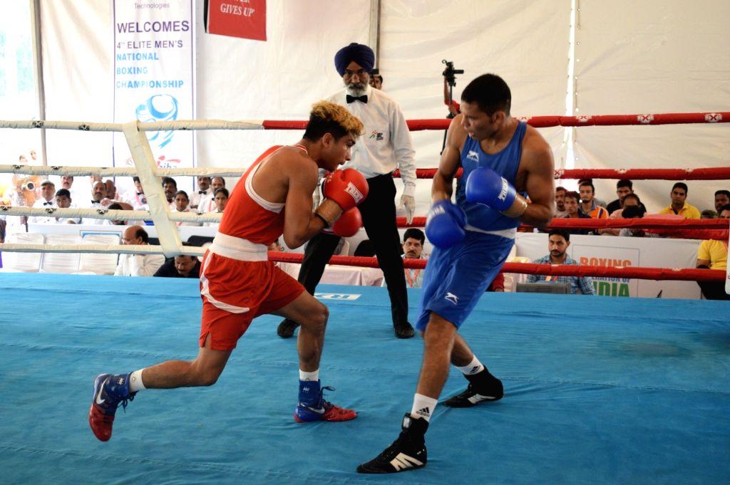 Assam's Shiva Thapa in action against Uttar Pradesh???s Abhishek Yadav during the Semi-finals in the 63 Kg category of 4th Elite National Men's Boxing Championship at Baddi University, in ... - Abhishek Yadav