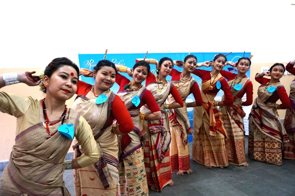 Assamese artistes perform Bihu dance during a cultural programme organised by Assam People's Welfare Association on the occasion of Rongali Bihu, in Noida on April 13, 2019.