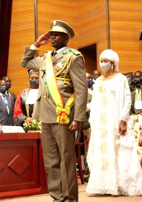 Assimi Goita (front) salutes the flag of Mali after being sworn in as Mali's transitional president in Bamako, Mali, on June 7, 2021..