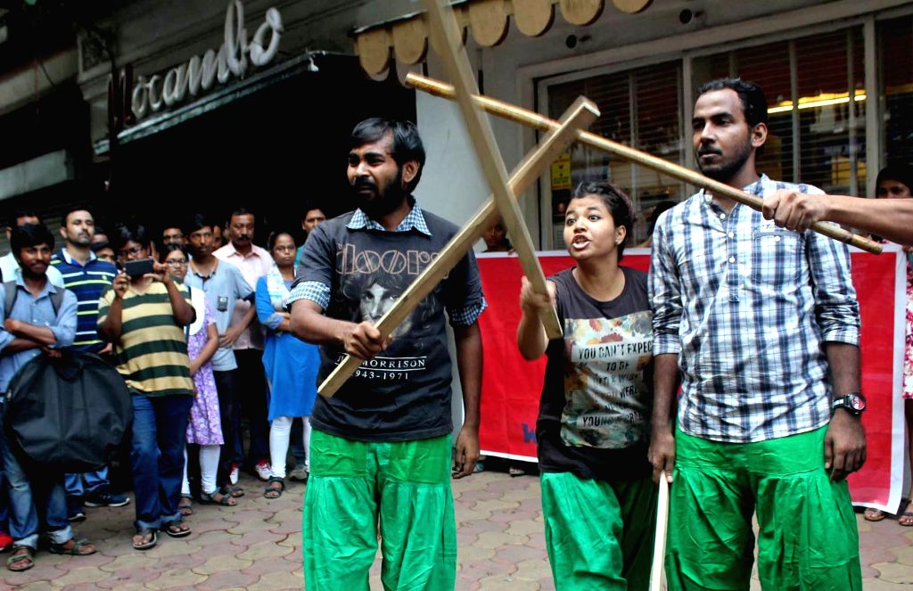 Association for Protection of Democratic Rights (APDR) activists perform a street play as they demonstrate against Mocambo restaurant in Kolkata on Sept 17, 2016.