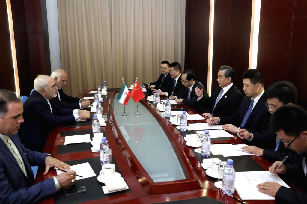 ASTANA, June 8, 2017 - Chinese Foreign Minister Wang Yi meets with his Iranian counterpart Mohammad Javad Zarif in Astana, Kazakhstan, June 8, 2017. - Wang Y