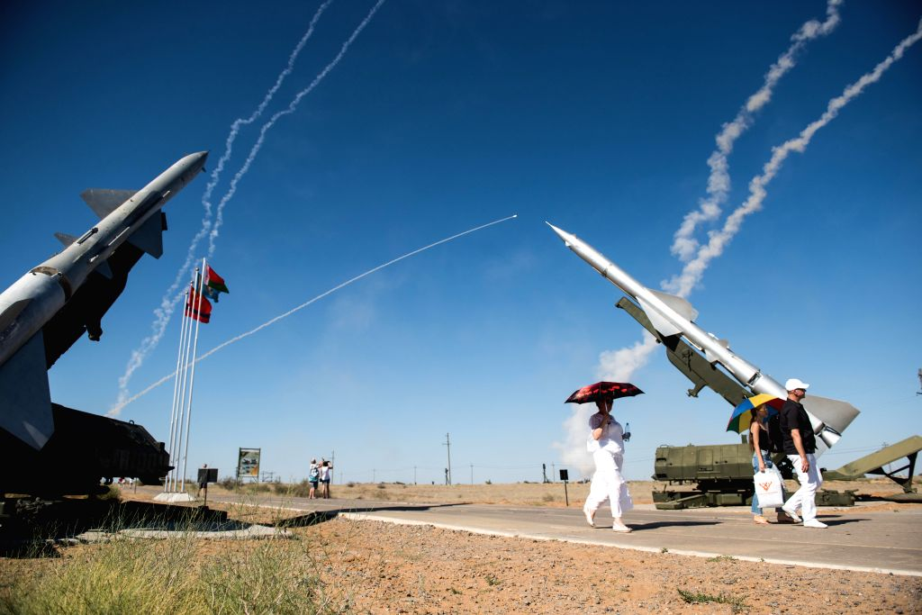 ASTRAKHAN, Aug. 6, 2017 - People walk past the site of the Keys to the Sky competition of the International Army Games 2017 at Ashuluk training area in Astrakhan region, Russia, on Aug. 5, 2017. The ...