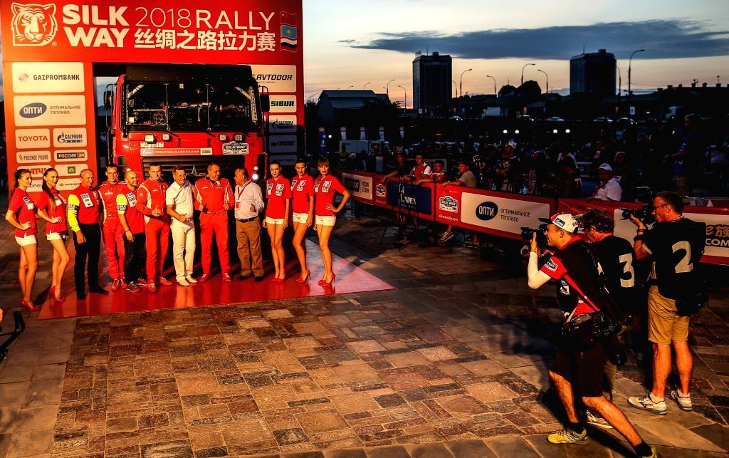 ASTRAKHAN, July 21, 2018 - Crew memebers of MAZ-Sportauto pose for photos during the opening ceremony of Silk Way Rally-2018 in Astrakhan, Russia, on July 20, 2018.