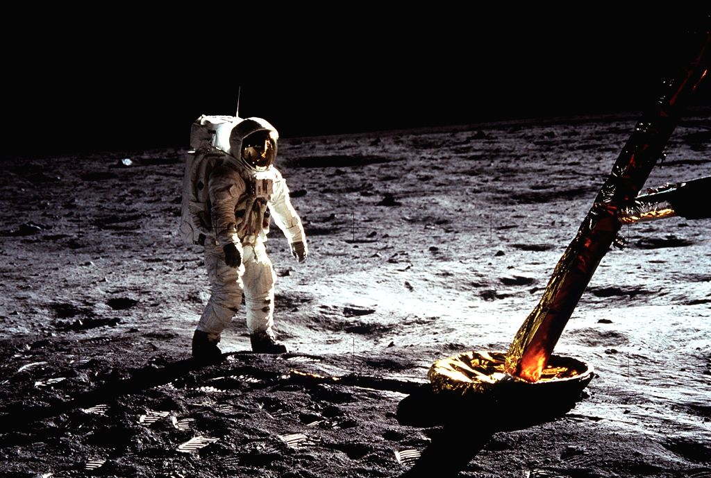 Astronaut 'Buzz' Aldrin walks on the surface of the Moon near a leg of the lunar module during Apollo 11.
