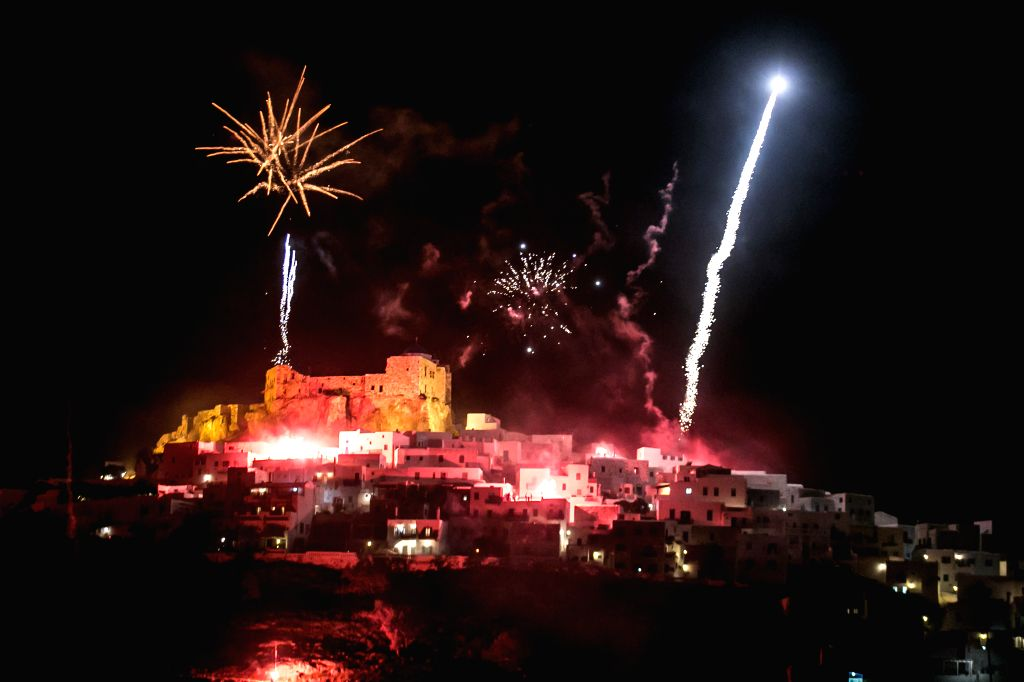 ASTYPALAIA, April 8, 2018 - Photo taken on April 8, 2018 shows fireworks over an ancient castle during the celebration of the Easter Sunday in Astypalaia, an Aegean Sea island about 300 km southeast ...