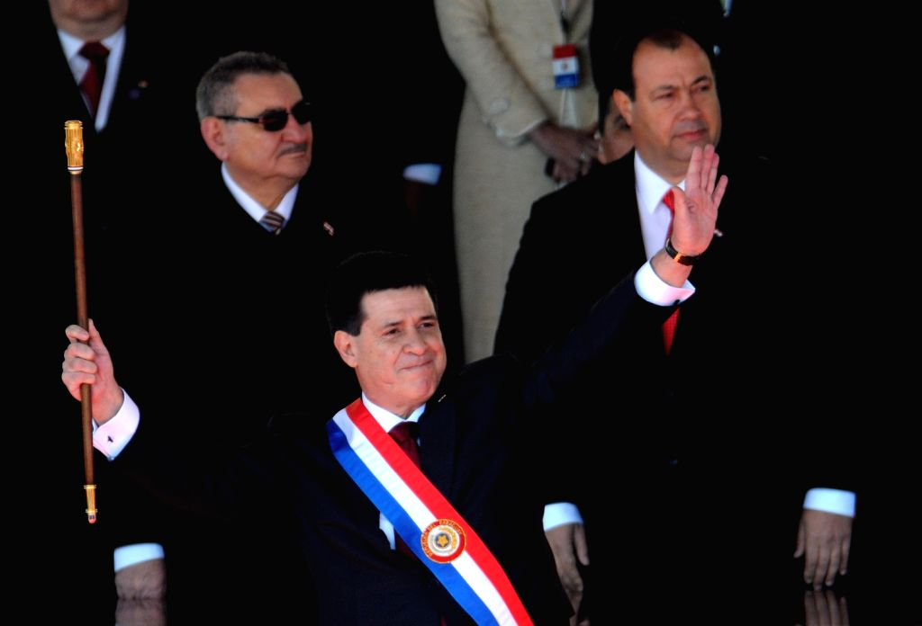 Paraguayan President, Horacio Cartes, holds the baton after being sworn in as President of Paraguay, in Asuncion, Paraguay, on Aug. 15, 2013. (Xinhua/Nicolas .
