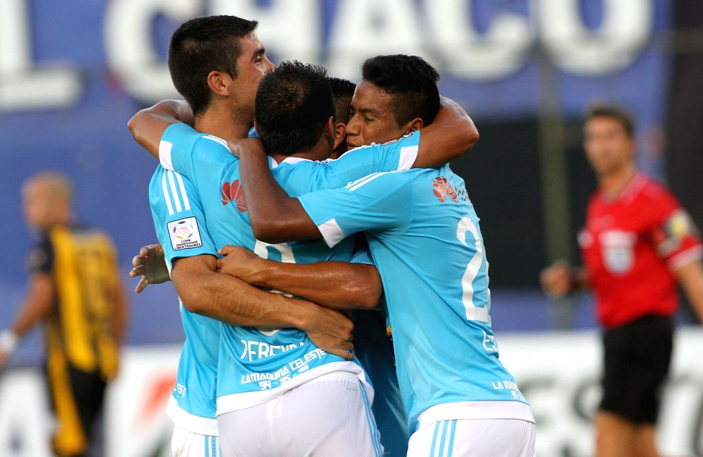 Players of Peru's Sporting Cristal celebrate a scoring during the match of Copa Libertadores against Guarani of Paraguay at the Defensores del Chaco Stadium in ...
