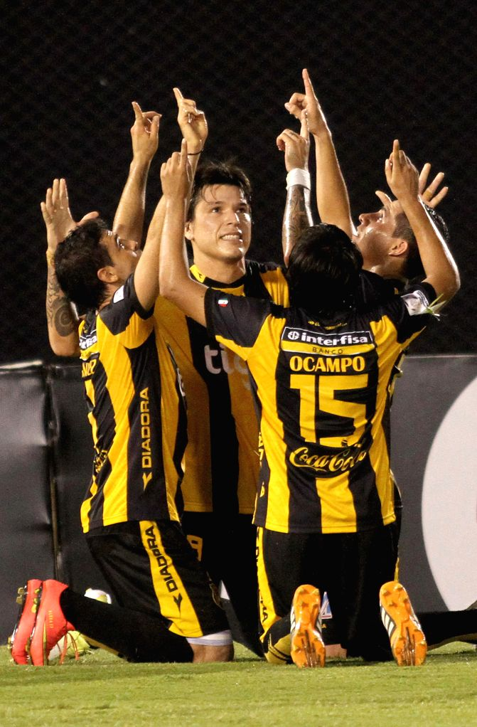 Guarani's players of Paraguay celebrate a scoring during the match of Copa Libertadores against Deportivo Tachira of Venezuela in the Defensores del Chaco Stadium ...