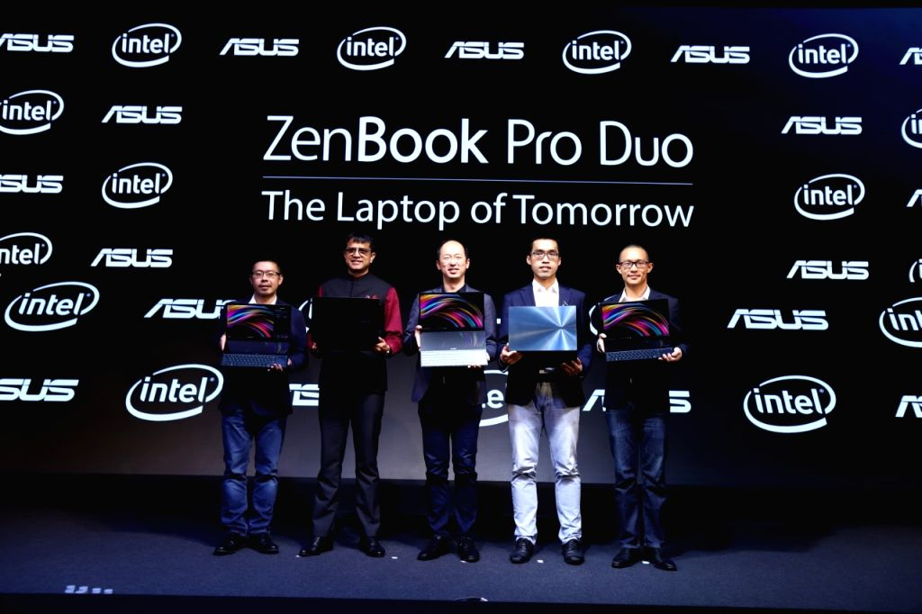 ASUS India Head of Consumer Notebooks and ROG Business Arnold Su and other officials at the launch of dual screen laptop series comprising of Zenbook Pro Duo (UX581) and the Zenbook Duo ...