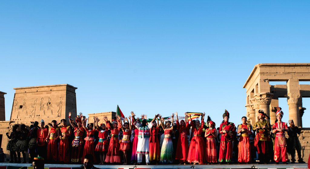 ASWAN (EGYPT), Oct. 27, 2019 Artists stage performance at Philae Temple in Aswan, Egypt, on Oct. 27, 2019. The fourth edition of the Afro-Chinese Arts and Folklore Festival kicked off on ...
