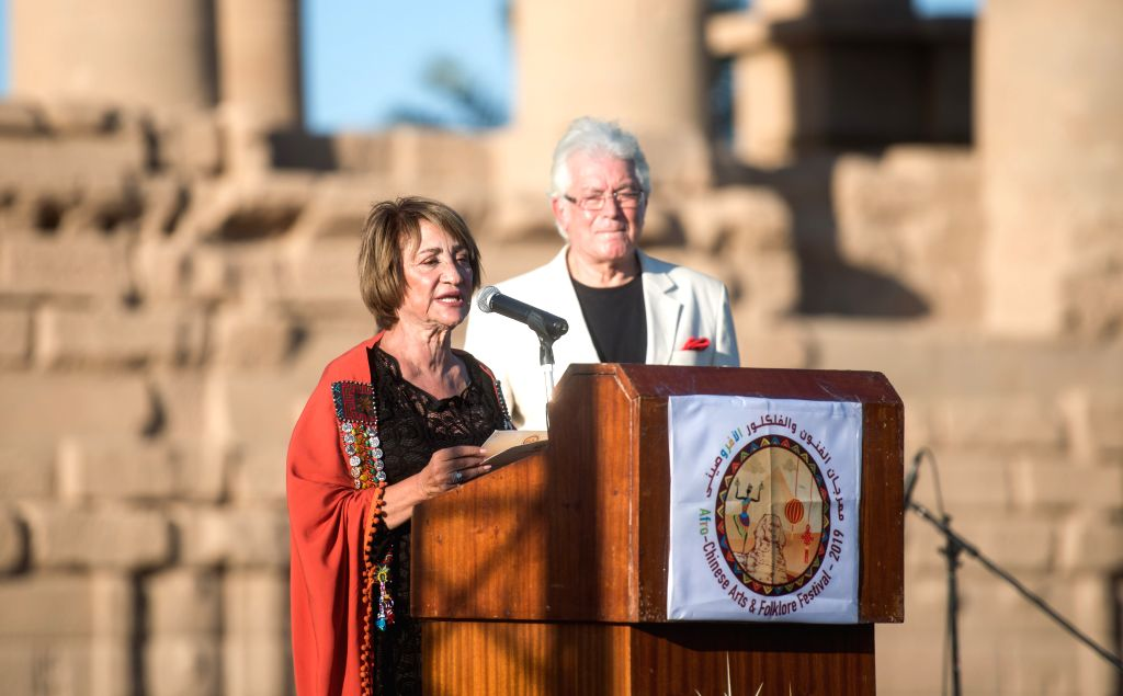 ASWAN (EGYPT), Oct. 27, 2019 Soheir Abdel-Qader (L), founder and chief of the Afro-Chinese Arts and Folklore Festival, speaks during the opening ceremony at Philae Temple in Aswan, Egypt, ...