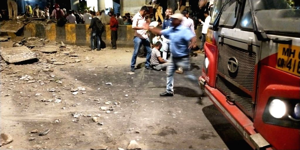 At least 12 commuters were injured when a portion of a pedestrian bridge crashed near the Chhatrapati Shivaji Terminus in Mumbai on March 14, 2019.