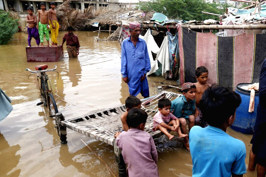 At least 12 people were killed after heavy rains lashed out various areas of Karachi in Pakistan for a second consecutive day on Sunday. (Str/Xinhua/IANS)