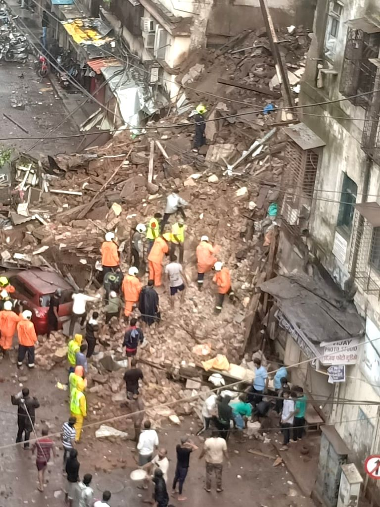 At least two persons were dug out of the debris of a 3-storied tenement which crashed due to heavy rains in Plot No. 8B, at Malvani in Malad west, Mumbai on July 16, 2020.