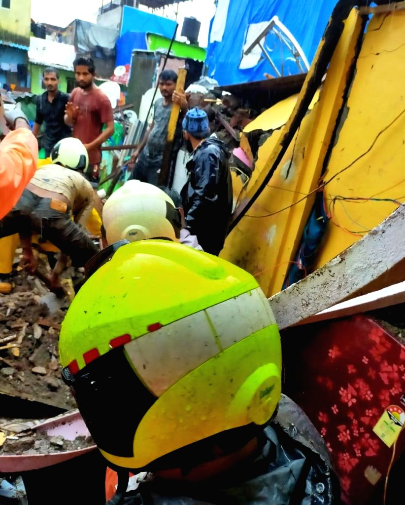 At least two persons were dug out of the debris of a 3-storied tenement which crashed due to heavy rains in Plot No. 8B, at Malvani in Malad west, Mumbai on July 16, 2020. (Photo: IANS)