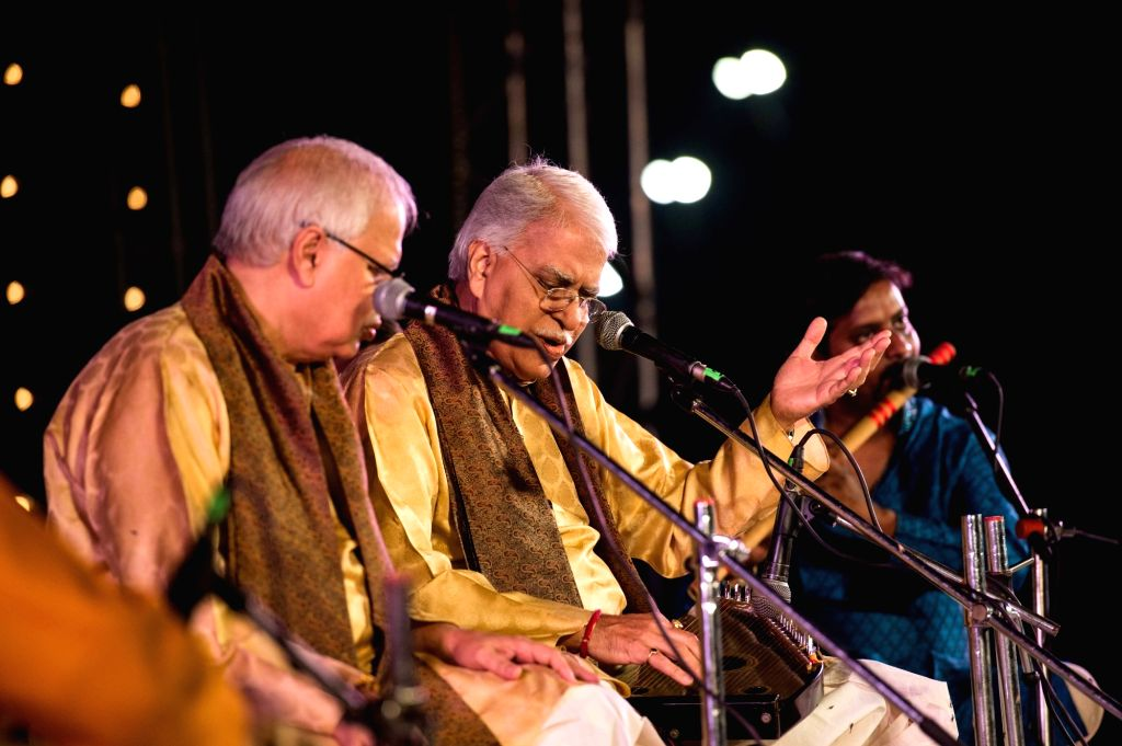 At the Assi Ghat, the sun set with the riveting performance of the legendary Hindustani Classical vocalist duo Pandit Rajan-Sajan Mishra, whose stellar voices served as a perfect conclusion ... - Pandit Rajan-Sajan Mishra