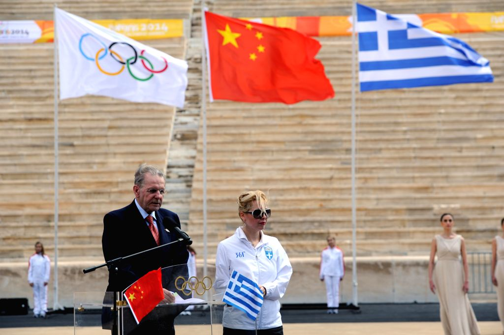 Former IOC President Jacques Rogge (L) makes a speech during a handover ceremony at Panathenaean Stadium in Athens, Greece, April 30, 2014. The flame for the ...