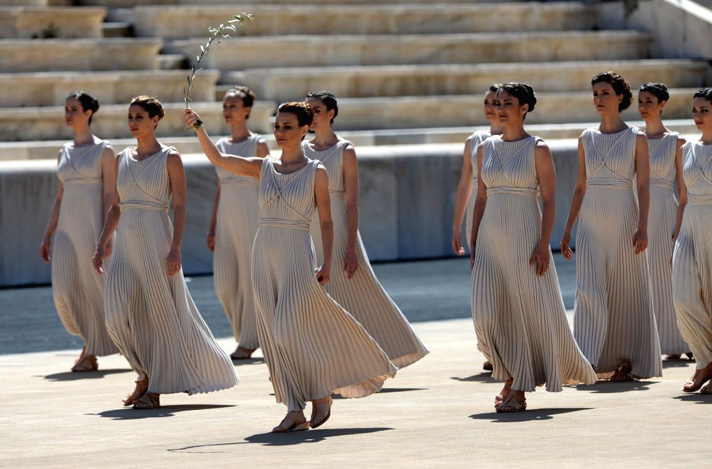 Greek actress Katerina Lehou (front), playing the role of high priestess, holds an olive branch during a handover ceremony at Panathenaean Stadium in Athens, ... - Katerina Lehou