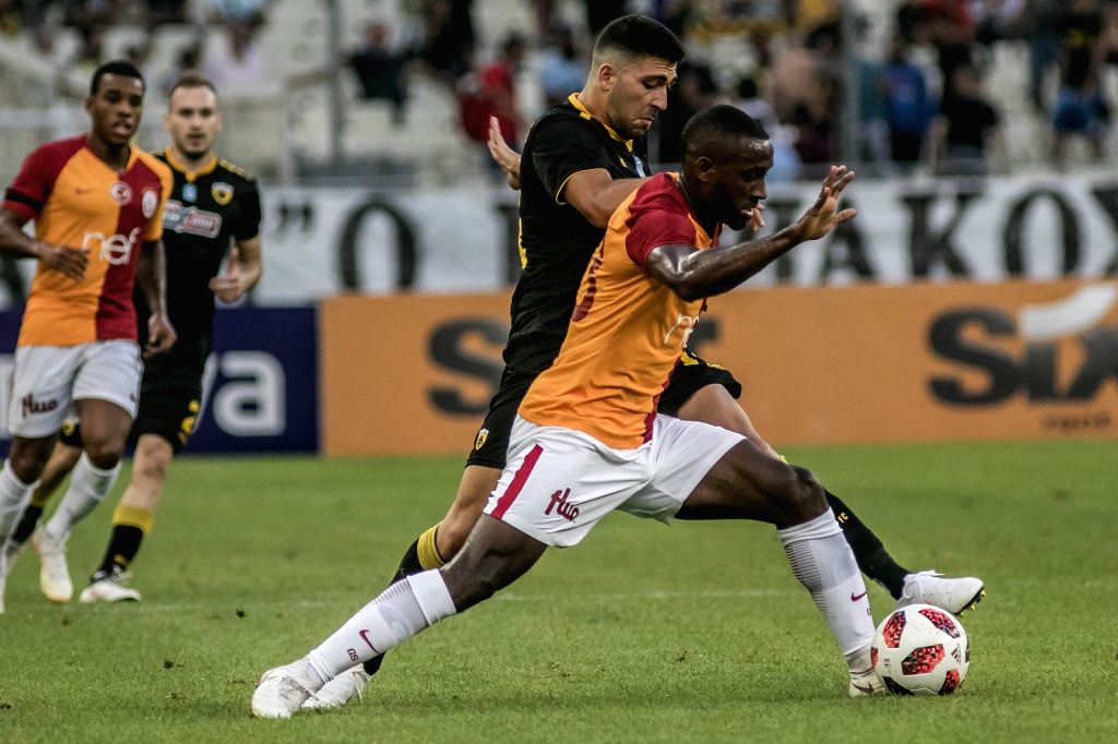 ATHENS, Aug. 1, 2018 - AEK Athens' Tasos Bakasetas (Back) vies with Galatasaray's Garry Rodrigues during the friendly soccer match at OAKA Spiros Louis Stadium in Athens, Greece, July 31, 2018.