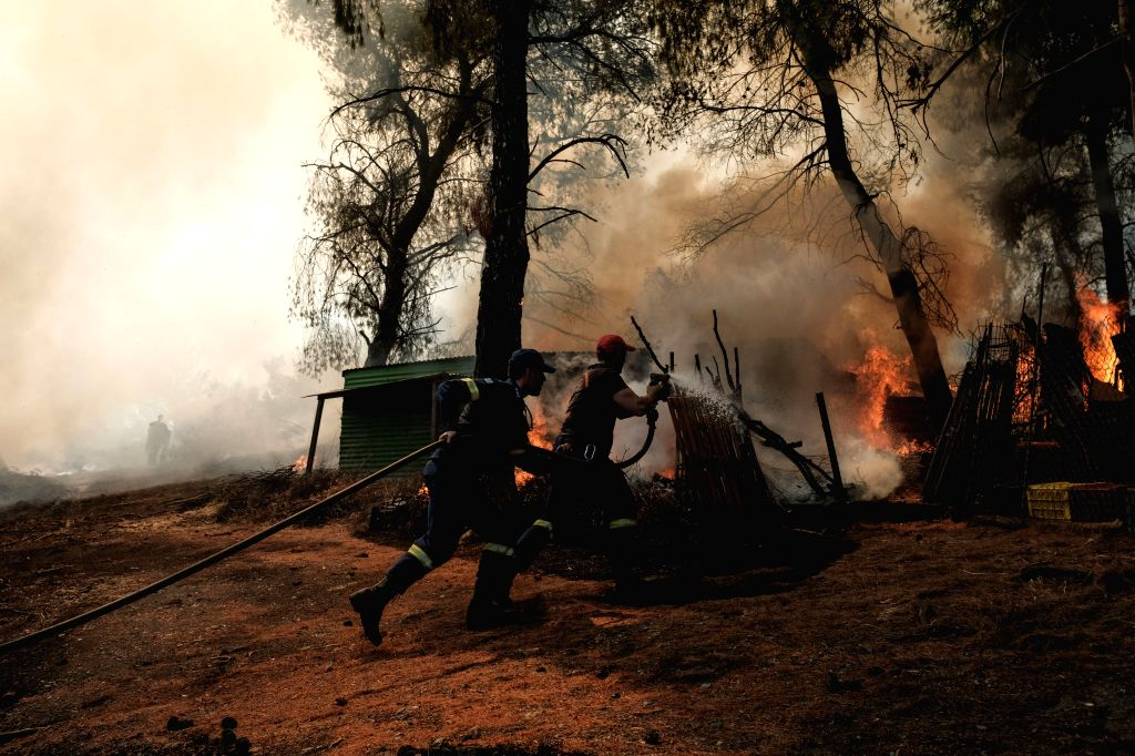 ATHENS, Aug. 15, 2019 - Fire fighters extinguish a blaze at Makrymalli village, on Evia island, Greece, on Aug. 14, 2019. Amid ongoing efforts to extinguish a destructive wildfire, Greek Prime ... - Kyriakos Mitsotakis