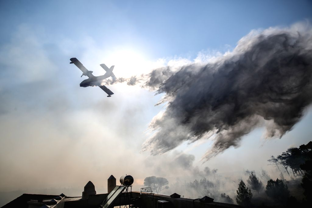 ATHENS, Aug. 6, 2017 - A firefighter plane tries to extinguish a wildfire on the Greek island of Kythera on Aug. 6, 2017. Greek island of Kythera was declared in a state of emergency on Saturday ...