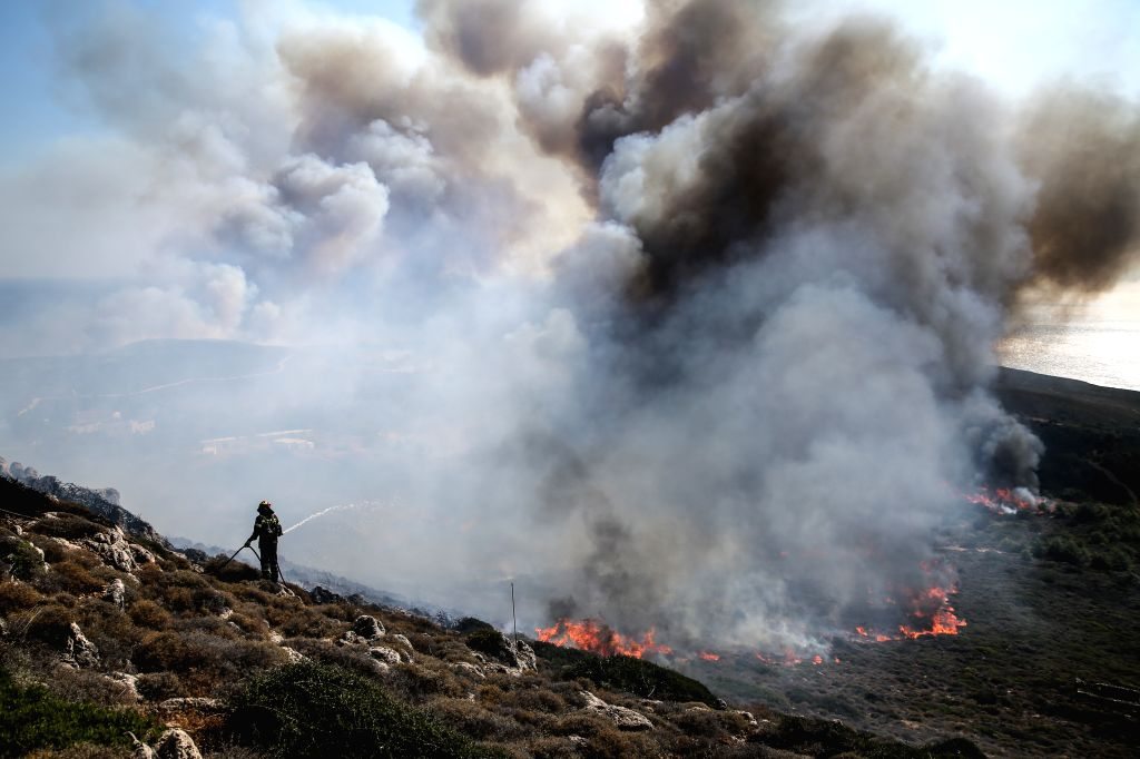 ATHENS, Aug. 6, 2017 - A firefighter tries to extinguish a wildfire on the Greek island of Kythera on Aug. 6, 2017. Greek island of Kythera was declared in a state of emergency on Saturday night due ...
