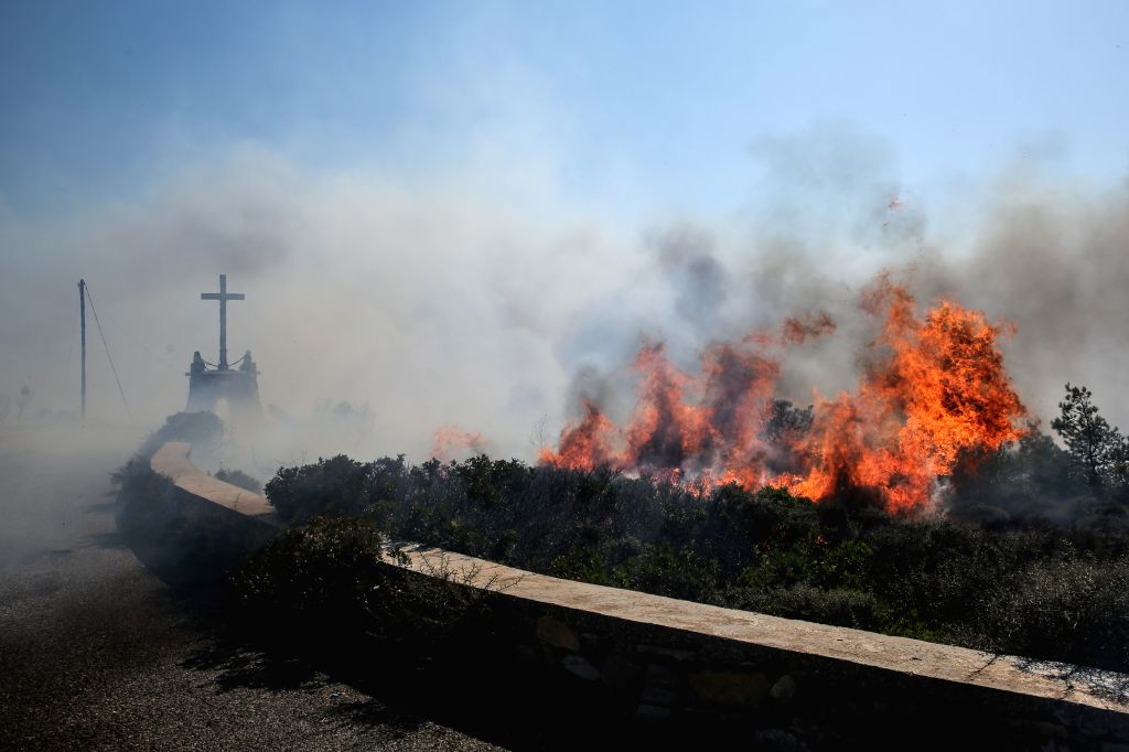ATHENS, Aug. 6, 2017 - Photo taken on Aug. 6, 2017 shows the wildfire on the Greek island of Kythera. Greek island of Kythera was declared in a state of emergency on Saturday night due to a raging ...