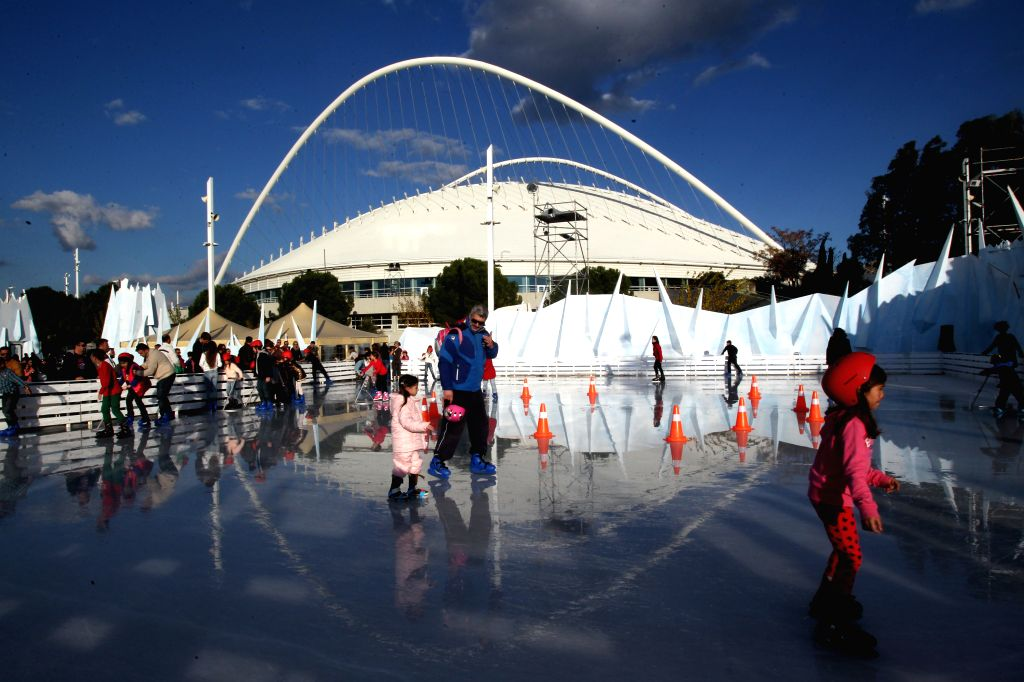 Children skate in a specially designed Christmas village in the space of Olympic venues in Athens, Greece, on Dec. 21, 2014. (Xinhua/Marios Lolos)