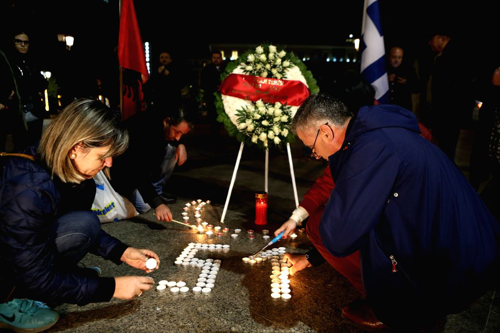 ATHENS, Dec. 3, 2019 - People light up candles during an event in memory of the victims of an earthquake in Athens, Greece, on Dec. 3, 2019. A week after a devastating quake hit Albania, Greeks ...