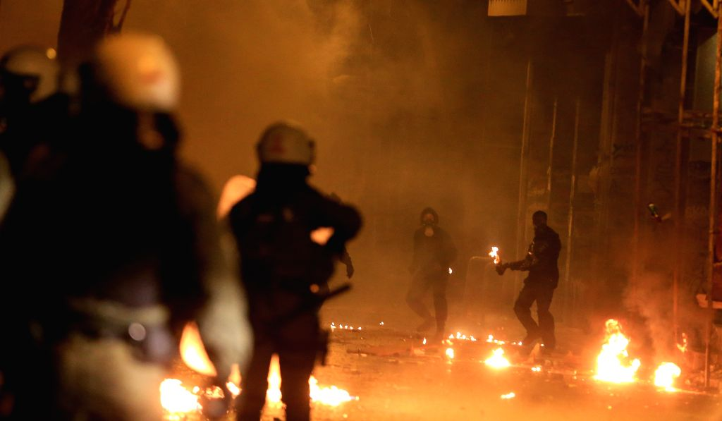 ATHENS, Dec. 6, 2018 - Riot policemen clash with demonstrators at Exarchia in Athens, Greece, on Dec. 6, 2018. Protests held in several Greek cities on Thursday in the memory of Alexandros ...