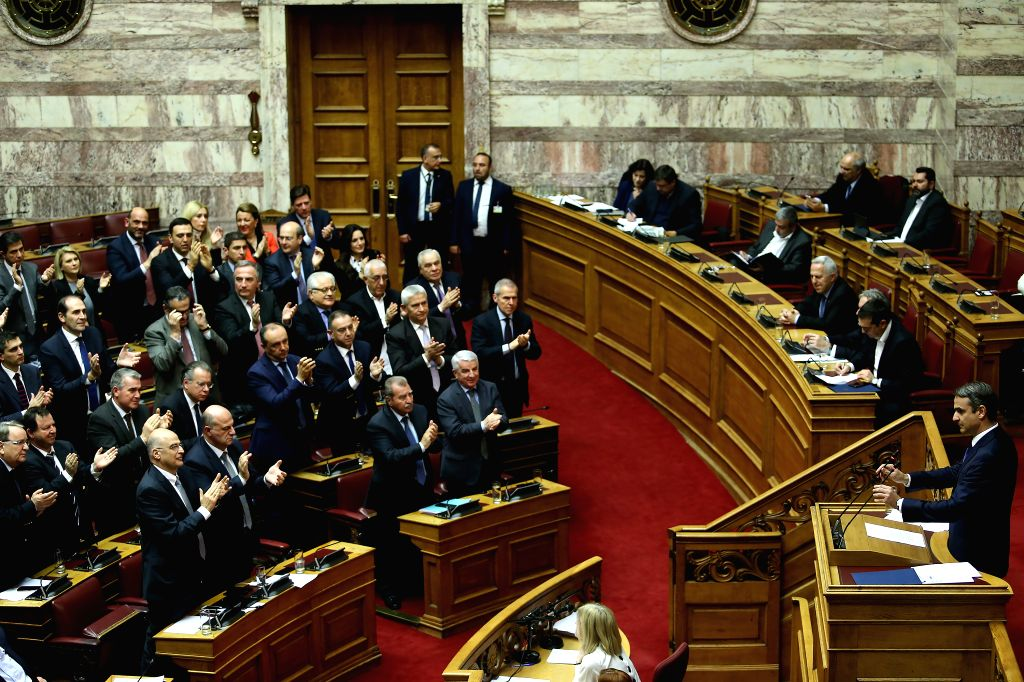 ATHENS, Feb. 8, 2019 - Greek main opposition New Democracy party leader Kyriakos Mitsotakis (R, Front) addresses Greek lawmakers on the Former Yugoslav Republic of Macedonia's (FYROM) NATO accession ...