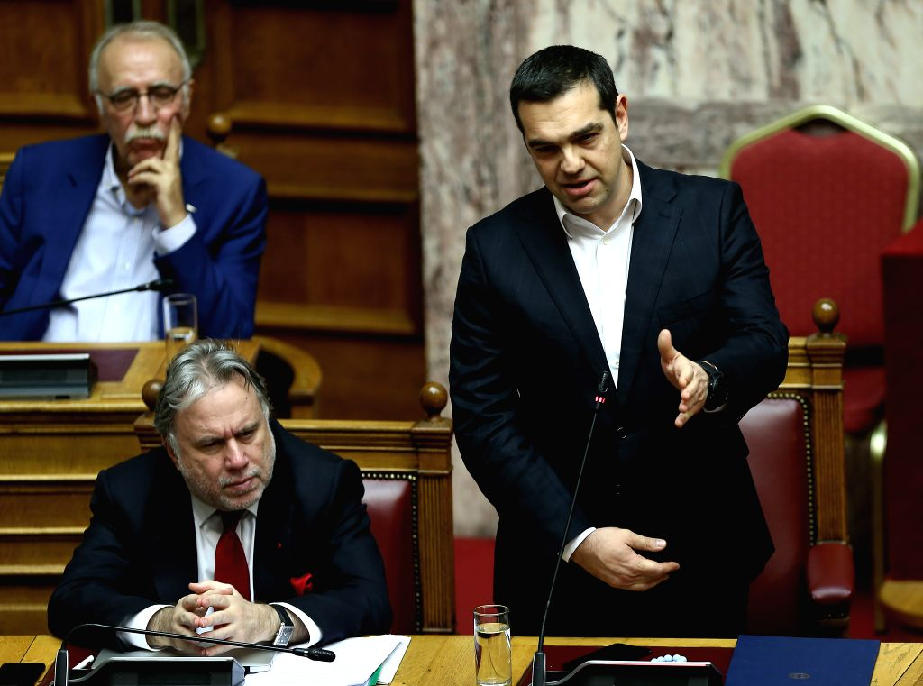 ATHENS, Feb. 8, 2019 - Greek Prime Minister Alexis Tsipras (1st R) addresses Greek lawmakers on the Former Yugoslav Republic of Macedonia's (FYROM) NATO accession protocol, in Athens, Greece, on Feb. ... - Alexis Tsipras
