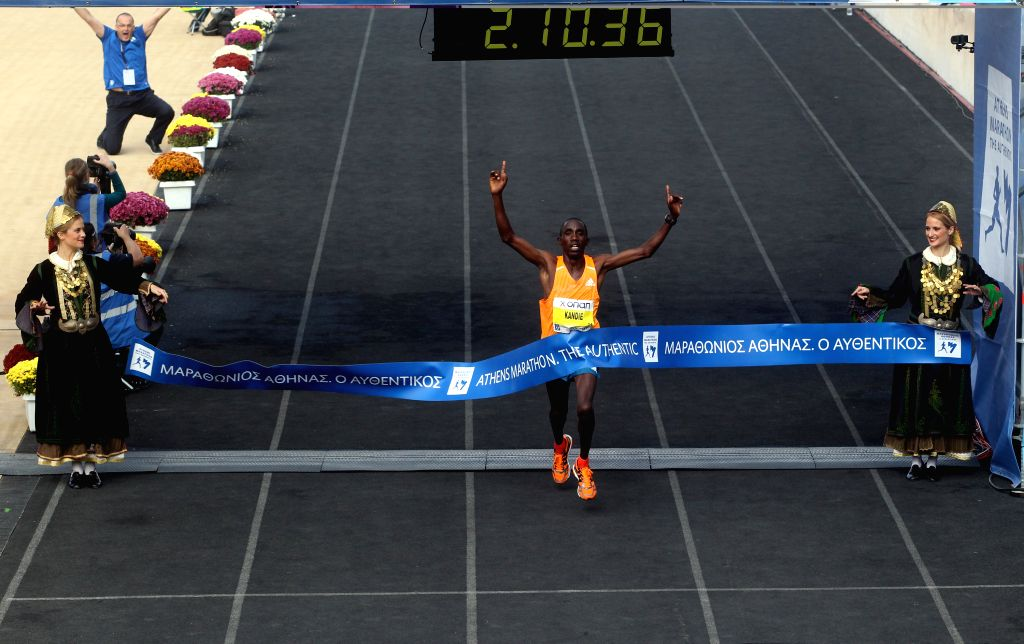 Athens (Greece): Kandie Felix Kipchirchir from Kenya crosses the finish line first during the 32nd Athens Classic Marathon the Authentic race inside Panathinaikon stadium in Athens, Nov. 9, 2014. A ..