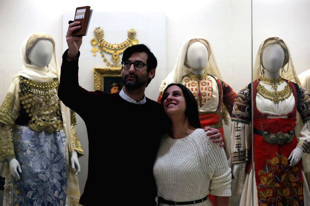 ATHENS, Jan. 17, 2018 - Visitors take selfies at the Benaki Museum of Greek Culture, one of the most significant museums in Greece, in Athens, Greece, on Jan. 17, 2018. A few years ago museum ...