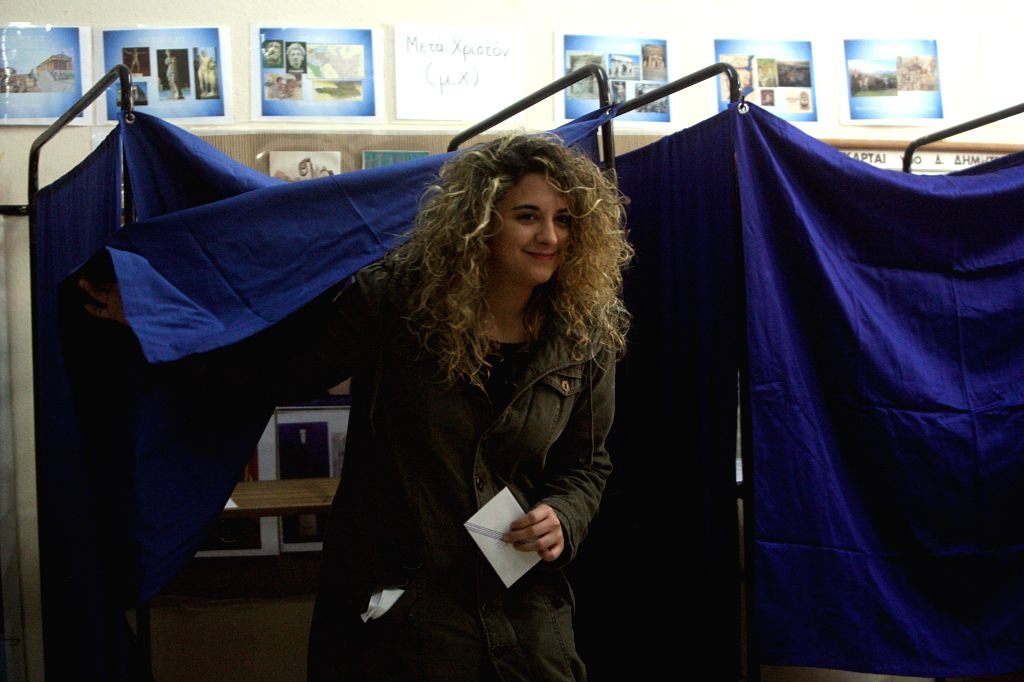 A woman casts her vote at a polling station in Athens, Greece, Jan. 25, 2015. Greek voters started casting their ballots Sunday in a snap general election that will .