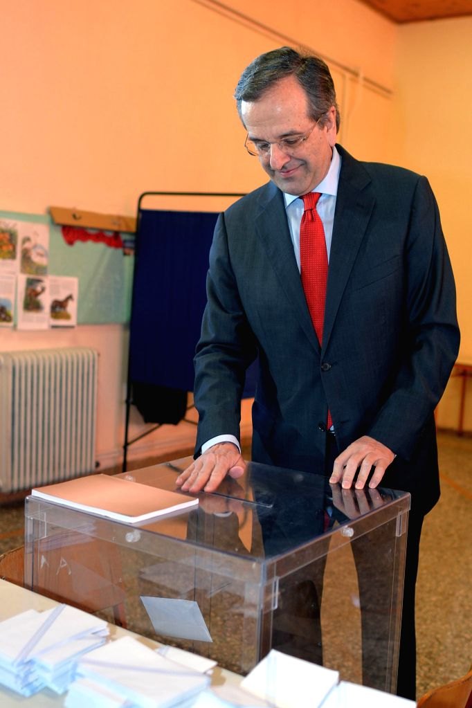 Greek Prime Minister and leader of the conservative New Democracy party Antonis Samaras casts his vote at a polling station in Pilos, Greece on Jan. 25, 2015. Greek .