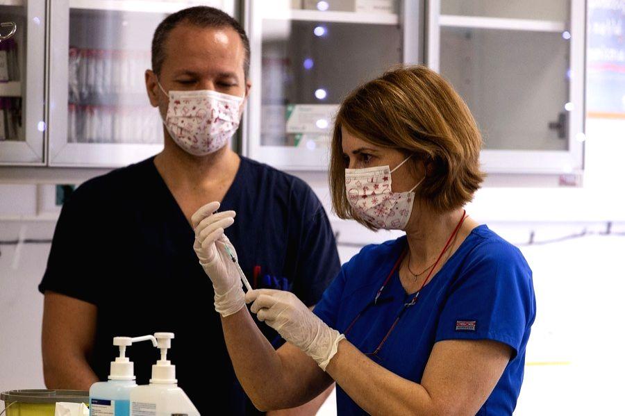 Athens, Jan. 3 (Xinhua) -- A health worker prepares a dose of COVID-19 vaccine at the Evaggelismos Hospital in Athens, Greece, Dec. 2020. (Pool via Xinhua/IANS)