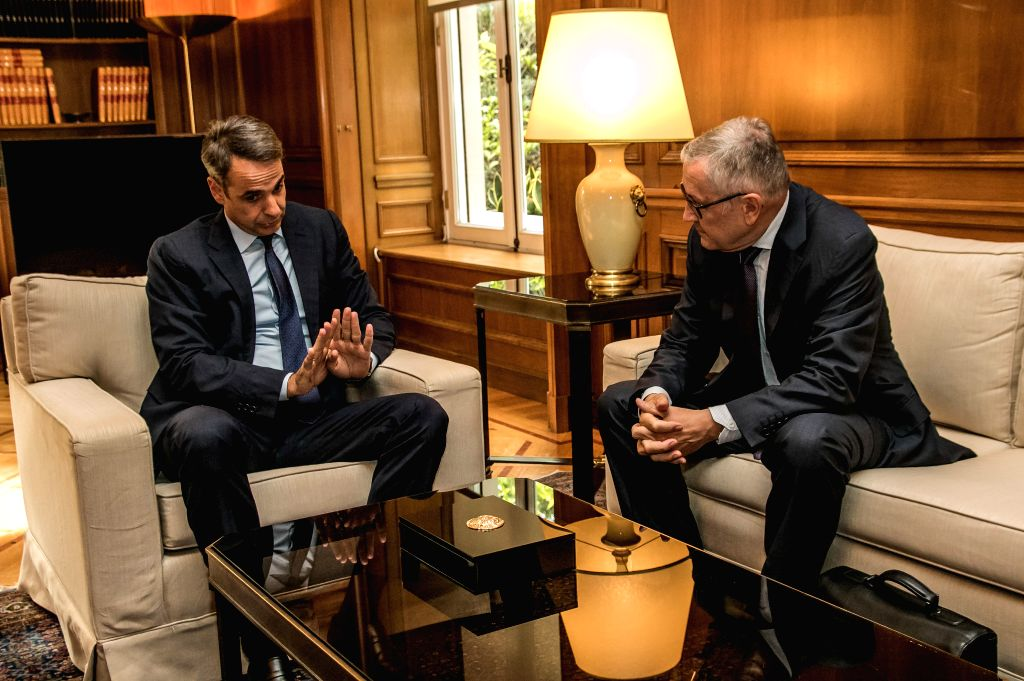 ATHENS, July 17, 2019 - Greek Prime Minister Kyriakos Mitsotakis (L) meets with Managing Director of the European Stability Mechanism (ESM) Klaus Regling at the Prime Minister's Office in Athens, ... - Kyriakos Mitsotakis