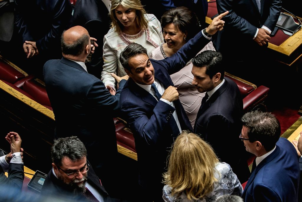 ATHENS, July 17, 2019 - Greek Prime Minister Kyriakos Mitsotakis (C) greets members of the parliament at the plenum of the Hellenic Parliament in Athens, Greece, on July 17, 2019. The 300 deputies of ... - Kyriakos Mitsotakis