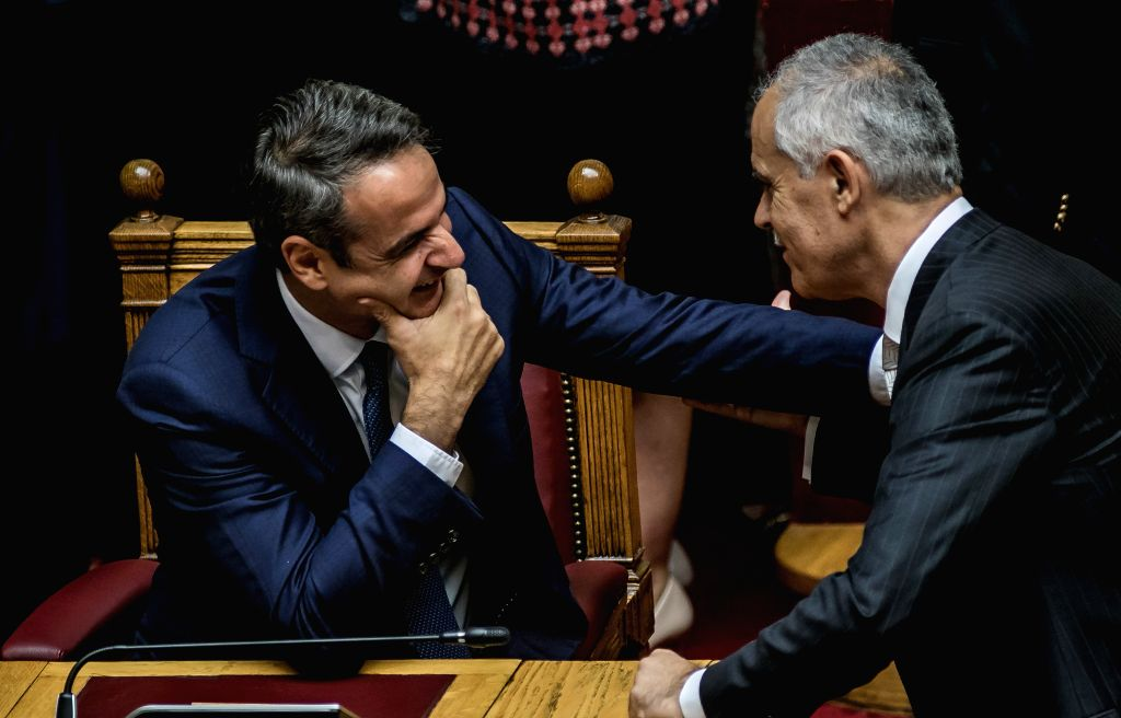 ATHENS, July 17, 2019 - Greek Prime Minister Kyriakos Mitsotakis (L) talks with a member of the parliament at the plenum of the Hellenic Parliament in Athens, Greece, on July 17, 2019. The 300 ... - Kyriakos Mitsotakis