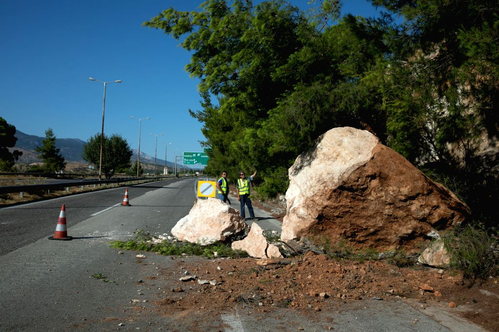 ATHENS, July 19, 2019 - Fallen rocks block part of a road following an earthquake in Athens, Greece, on July 19, 2019. A strong earthquake measuring 5.1 on the Richter scale jolted Athens on Friday, ...