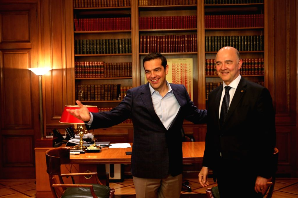ATHENS, July 25, 2017 - Greek Prime Minister Alexis Tsipras (L) welcomes European Commissioner for Economic and Financial Affairs Pierre Moscovici in Athens, Greece, July 25, 2017. - Alexis Tsipras