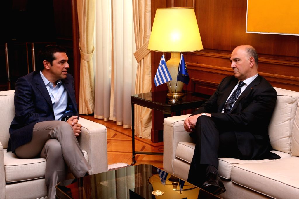 ATHENS, July 25, 2017 - Greek Prime Minister Alexis Tsipras (L) meets with European Commissioner for Economic and Financial Affairs Pierre Moscovici in Athens, Greece, July 25, 2017. - Alexis Tsipras