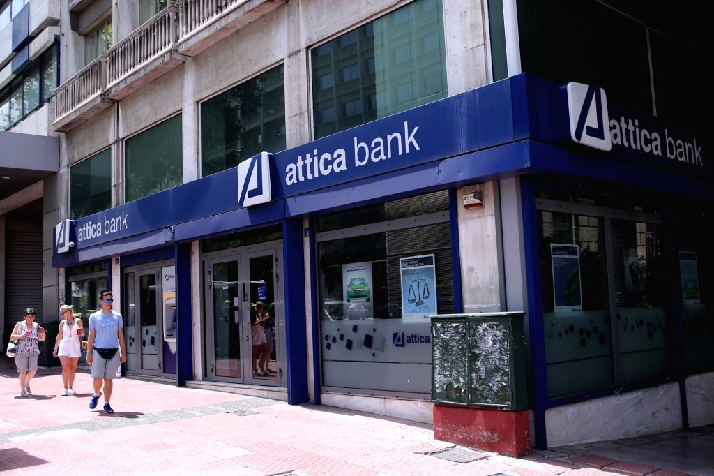 ATHENS, July 25, 2017 - Pedestrians walk in front of a bank in Athens on July 25, 2017. Greece made a test return to bond markets on Tuesday for first time after the summer of 2014.