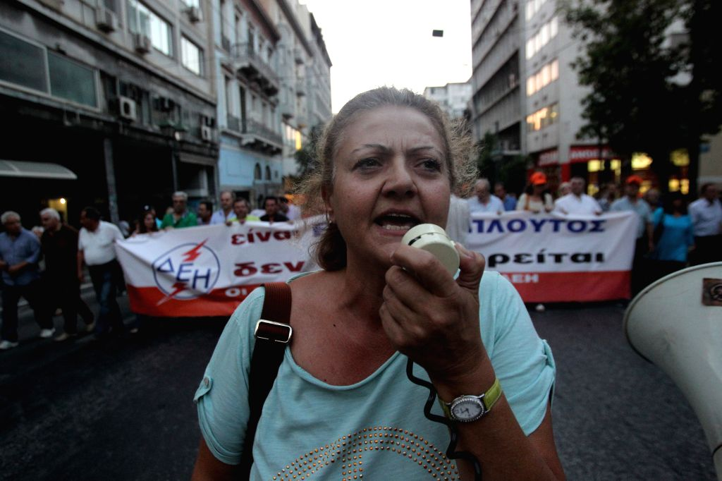 Protesters take part in a rally organized by workers of Public Power Corporation in central Athens, Greece, on July 3, 2014. Workers of Public Power Corporation went .